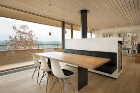 This Black Banquette Attached To The Back Of A Room Divider With Fireplace On Other Side Matches Steel Legs Dining Table And