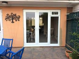 Front Door Side Window Curtain Rods by Front Door Side Window Shutters Sidelight Windows Panel Coverings