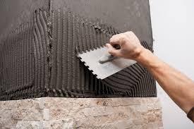 use a v notch or square notch tile trowel