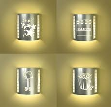 four or more silver home theater sconces with filmstrips