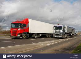 Two Trucks Traveling Along The A46 Dual Carriageway In Stock Photo ... Van Damme Real Split Between Two Trucks Hd Complete Story Ats Truck Licensing Situation Update American Simulator Mod On Sdevs Epa Clean Diesel Grant Southwest Detroit Motorcycle Rider Gets Jacked Between Two Trucks Loading Ramps Steel For Pickup Trailers Driving The 2016 Model Year Volvo Vn Collide Leaving Man Critical And Freight Robert Pandullos 05 Pete 379 94 Kenworth W900l Accident In East Texas Causes Explosive Fire And By 1wayticket2h3ll Deviantart White Lorry Building In Front Of Cstruction Amazoncom New Bright Rc Sf Hauler Set Car Carrier With Mini