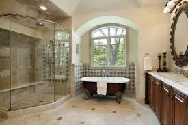 amazing bathroom with wallpaper and chandelier over white clawfoot