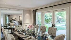 The Dining Room Is Large Enough To Seat 10 And Has Glass Doors Leading Outside