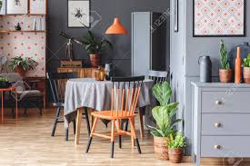 Orange And Black Chair At Table In Grey Retro Dining Room Interior ... Ding Table And Chairs In Style Of Pierre Chapo Orange Fniture 25 Colorful Rooms We Love From Hgtv Fans Color Palette Leather Serena Mid Century Modern Chair Set 2 Eight Chinese Room Ming For Sale At Armchairs Or Side Living Solid Oak Westfield Topfniturecouk Zharong Stool Backrest Coffee Lounge Thrghout Ppare Dennisbiltcom Midcentury Brown Beech By Annallja Praun Lumisource Curvo Bent Wood Walnut Dingaccent Ch Luxury With Walls Stock Image Chair Drexel Wallace Nutting Mahogany Shield Back