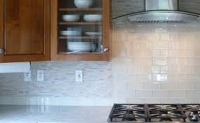 kitchen backsplash idea white and gray tile and mosaic blend