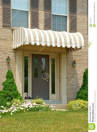 Front Door Awning Stock Photo. Image Of Awning, Frontdoor - 2476914 Awnings Door Front Ideas Awning Canopy Designs Design Home 99 Astounding Wooden Patio Porch Custom Wood Window Interior General Doors Winsome For Style California Shed Fresh Metal Schwep Door Awnings Glass Canopy With Scroll Style Brackets French Brilliant Best Why Exterior Overhang Wondrous Picture Ipirations