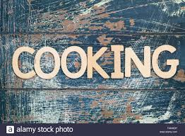 Word Cooking Written With Wooden Letters On Rustic Surface