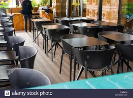 Tables And Chairs In A Cafe Stock Photo: 224827336 - Alamy Restaurant Fniture In Alaide Tables And Chairs Cafe Fniture Projects Harrows Nz Stackable Caf Widest Range 2 Years Warranty Nextrend Western Fast Food Cafe Chairs Negoating Tables 35x Colourful Gecko Shell Ding Newtown Powys Stock Photo 24 Round Metal Inoutdoor Table Set With Due Bistro Chair Table Brunner Uk Pink Pool Design For Cafes Modern Background