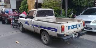 100 Trucks Paper Thailand Day 2 Mazda Familia 1400e With Top Cover With News Paper