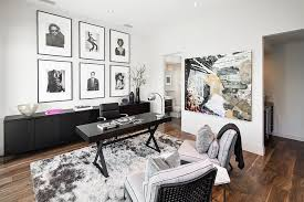 A Collection Of Black And White Framed Photographs Wall Add To The Neutral Color Scheme