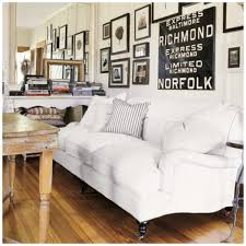 White Fabric English Roll Arm Sofa With Pillow Cushion Accent On Hardwood Floor Also Rustic Table