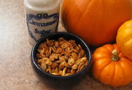 Preparing Fresh Pumpkin For Pies by Sugar And Spice Roasted Pumpkin Seeds