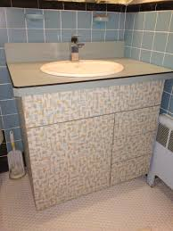 A Bathroom Vanity Made With Wilsonart's Patterned