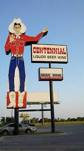 Centennial Liquor Sign In Dallas Texas Referencing Big Tex