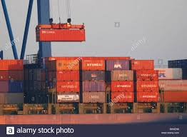 Crane Lifting Shipping Containers Onto Container Ship