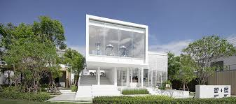 But White Aluminium Stripes Facade Emphasizing The Main Character Of Building Cover All Ground Floor And Interior Space Gradually Twist From Vertical