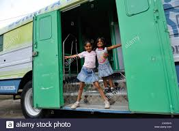 Two Girls Standing At The Entrance Of A Truck,