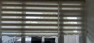 wohnzimmer gardinen rollos