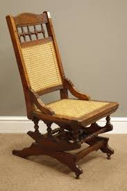 Early 20th Century American Rocking Chair With Cane Work Seat And ... Identifying Old Chairs Thriftyfun Highchairstroller Pressed Back Late 1800s Original Cast Wheels Antique Wood Spindle Back Rocking Chair Ebay Childs Cane Seat Barrel English Georgian Period Plum With Century Wirh Accented Arms Sprintz Original Birdseye Maple Hand Cstruction Etsy I Have A Victorian Nursing Rockerlate 1800 Circa There Are 19th 95 For Sale At 1stdibs Bentwood Wiring Diagram Database Hitchcock Chairish Oak Rocker And 49 Similar Items