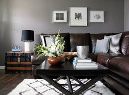 Homey Modern Rustic Living Room Featuring Ark Brown Leather Couch With Cross Leg Black Wooden Coffee Table And Side Chest End Fabric Shade