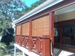 Roll Up Patio Screens by Exterior Brown Bamboo Roll Up Window Blind Hanging On Wooden Deck