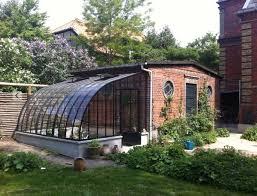 serre adossée contre abri de jardin dbg classics véranda