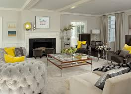 yellow and gray living room with light gray velvet tufted curved