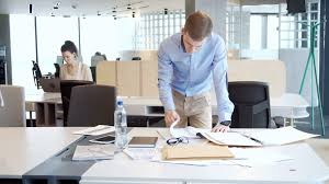 Young Working Entrepreneur Look For Information Among Piles Of Papers Documents And Folder Business