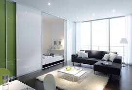 white frosted glass room partition connected by l black leather