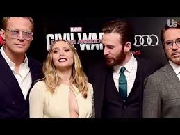 Chris Evans Cant Stop Staring At Elizabeth Olsens Red Carpet Cleavage