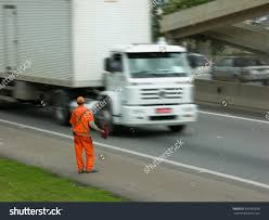 Flagman Signals Cars Trucks Go By Stock Photo 692982328 - Shutterstock Cars And Trucks Things That Go Quilt Blueberry Hill Crafting That Amazoncouk Richard Scarry Wont Go Out Of Style Pdf Free Read Online Left Hand From Germany Tel 49 1626903682 Book Club Why Scarrys Busytown Has The Worst City Orange Dodge Charger With Black Rims And Pinterest Under Dust Rust New Classic Up For Auction Wcai Key West Ford Trucks Used By Sales Service Gokart World