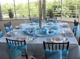 winter wedding theme blue chair sashes and table decor blue