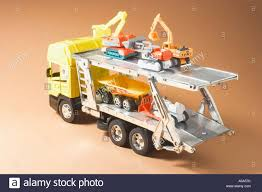 100 Toy Farm Trucks And Trailers Truck Carrying Miniature Machineries Stock Photo