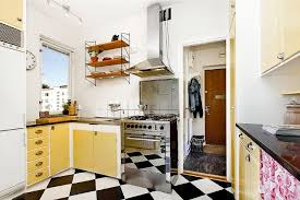Minimalist Vintage 50s Kitchen Decor With Cream Cabinet And Small Shelf Also Stainles Steel Cooktop Plus Black White Tile