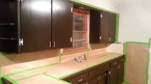 Interesting Wooden Kitchen Cabinet Using Brown Java Gel Stain With Silver Handle For Decor Ideas