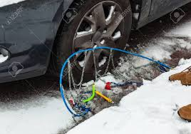 Snow Chains Near The Car Tire In Winter On Snow Stock Photo, Picture ...