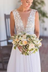 Bride In Mira Zwillinger Wedding Dress From Carines Bridal Atelier Holding Rustic Bouquet