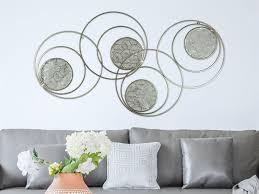 metallbild ringe wandbild wohnzimmer kreise mit