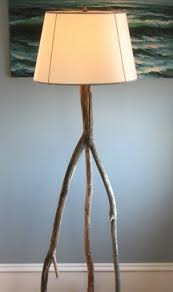 Driftwood Floor Lamp Via Completely Coastal