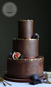 Dark Chocolate Ganache Wedding Cake With Edible Gold Leaf And Winter Berries Is Guinness