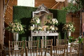 A Vintage Vanity Decorated With Lush White Floral Arrangements Served As The Backdrop For Couples