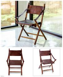 Fair Trade Modern Wood And Leather Folding Chair - Java Dutch | NOVICA Set Of Six Italian Iron Leather Folding Chairs Circa 1950 Fniture Pair Wood Inessa Stewarts Antiques Millwards Wooden Chair Anthology Vintage Hire Worldantiquenet Old And Danish Made Iron Wood Garden Folding Chair Manssartoux Stock Robinia Spring Outdoor In Fiam Amazoncom Biscottini 2 Antique Handicrafts Directors Style With Frame Sturdy French And Vinterior Antique French Folding Chair Bi3 Portable Seating Multipurpose For