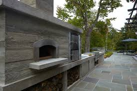 Patio with Rustic PIzza Oven and Meat Smokers Transitional