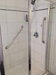 interior bathroom shower stall design with stainless frame of