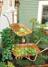 Recycle Old Wheelbarrows Into A Charmingly Rustic Garden Fountain With This DIY Project