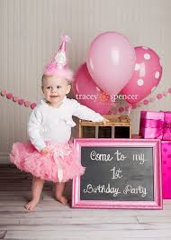 Photograph of a oneyearold inviting everyone to her 1st birthday