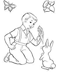 Little Boy Feeding Easter Bunny Coloring Page