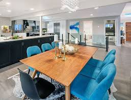 Seattle Contemporary Dining Room Design With Blue Color Chairs