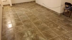 tile bathroom floors with wood baseboard bathroom floor baseboard