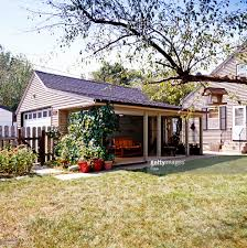 Porch Attached To Garage In Backyard Stock Photo   Getty Images Patio Ideas Backyard Porches Patios Remarkable Decoration Astonishing Back Patio Ideas Backpatioideassmall Covered Porchbuild Off Detached Garage Perhaps Home Is Porch Design Deck Pictures Back Under Screened Garden Front Planter Small Decorating Plans Best 25 Privacy On Pinterest Outdoor Swimming Pools Resorts Living Nashville Pergola Prefab Metal Roof Kit Building A Attached Covered Overhead Coverings
